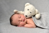 sleeping newborn teddy olufemiphotography