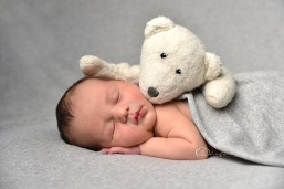 sleeping newborn teddy olufemiphotography