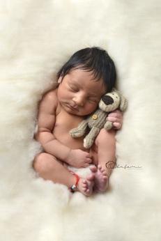 sleepy newborn with bear olufemiphotography